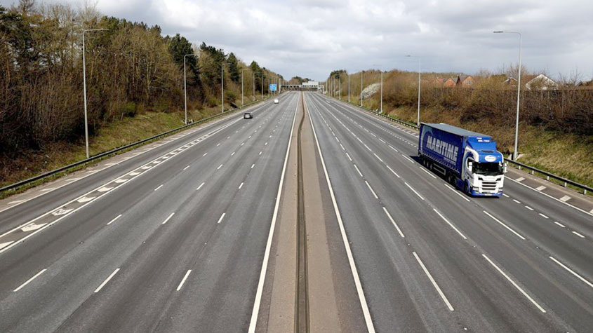 Empty UK motorway as a result of the COVID-19 impact on travel