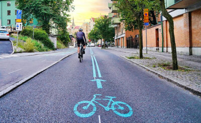 Image of a cyclist travelling on an empty street as a result of lockdown