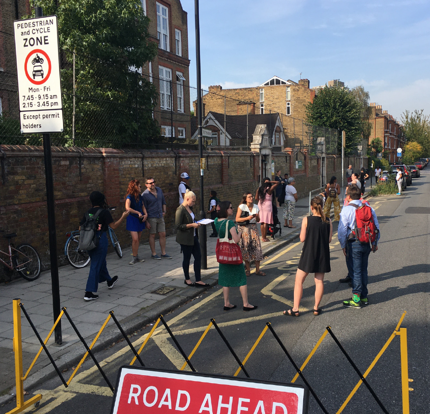 Parents and kids gathering outside a school street
